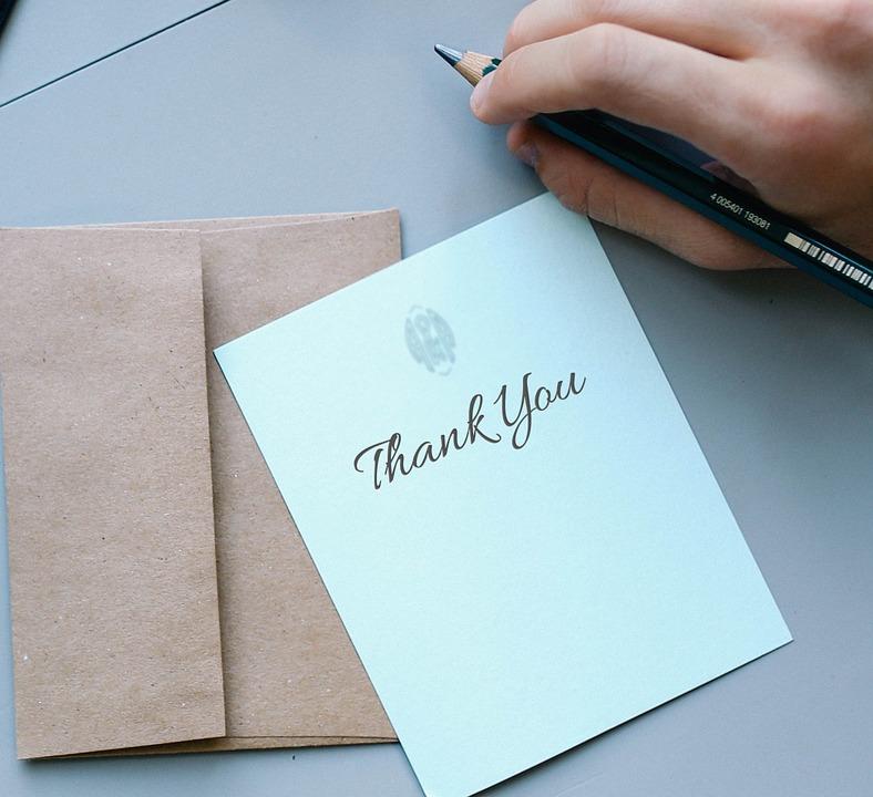 thank you written on a card