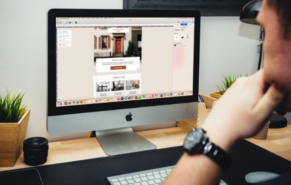 Graphic designer using Mail Designer 365 on an iMac