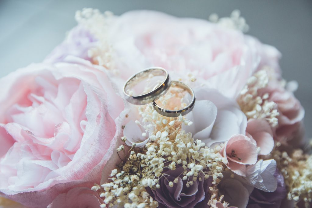 Wedding rings and flower display