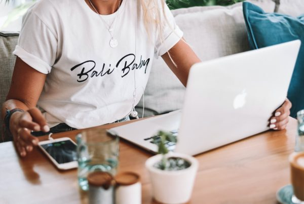 women working on a macbook