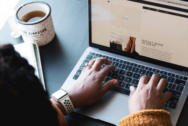 woman working on MacBook